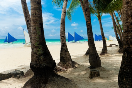 traditional paraw sailing boats on white beach on boracay island, Philippines Stock Photo