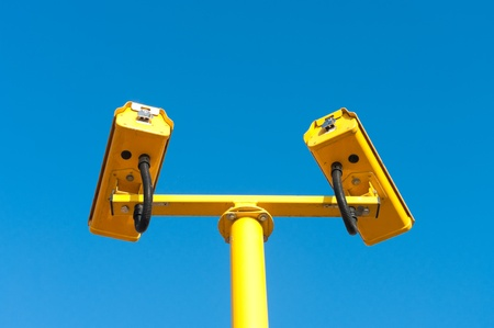 double surveillance security camera or CCTV against blue sky photo