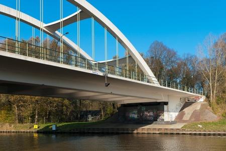 concrete arch bridge over the Twente canal in Hengelo, Netherlands photo