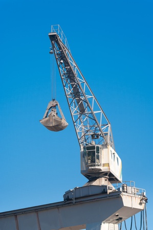small crane at a cement factory used for unloading the ships photo