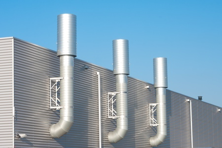 three chimneys on an industrial building