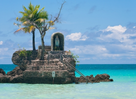 holy maria statue on a rock in the sea on Boracay island, Philippines