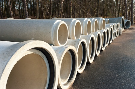 concrete drainage pipes on a newly built industrial area photo