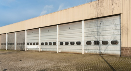 industrial unit with old and damages roller shutter doors photo