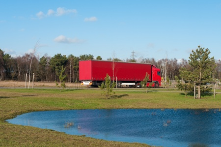 red polish truck waiting for work on an industrial area in the netherlands photo