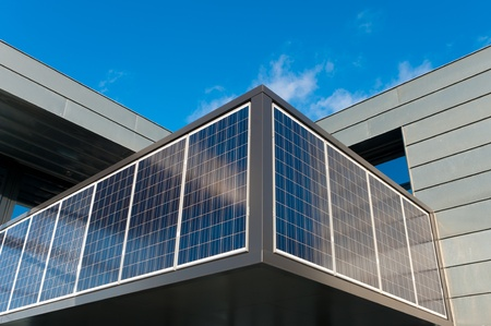entrance of a modern office building with solar panels for energy supply photo