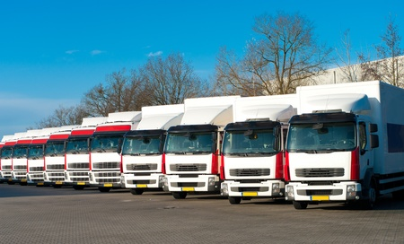 several trucks parked in a perfect row