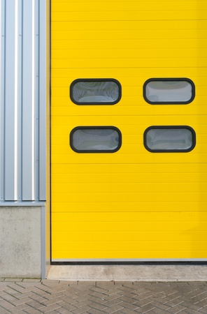 detail of a yellow industrial roller door photo