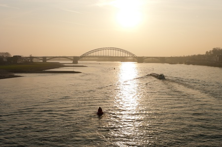 arch bridge over the Waal river at Nijmegen, netherlands photo