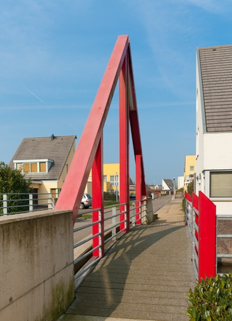 modern red footbridge in Beuningen, Netherlands photo