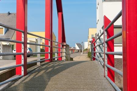 modern red footbridge in Beuningen, Netherlands photo