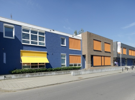 sunshades: modern building with yellow and orange sunshades on a hot day