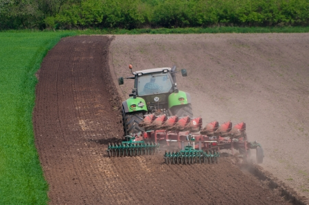 ploughing field: farmer ploughing field in Germany Stock Photo
