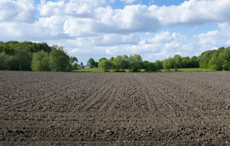 ploughed field under a nice cloudy sky Stock Photo - 14118649