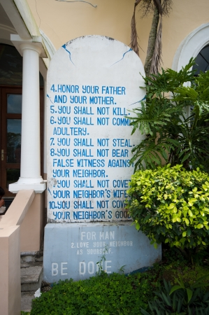 bible ten commandments: some of the commandments on a stone at the entrance of a church in Naga City, Philippines