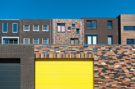back view of newly build modern new houses in the Netherlands with a yellow garage door photo