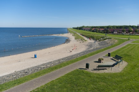 view over a small beach along the IJsselmeer in the Netherlands photo