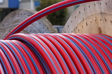 cable drum with red cable on it Stock Photo