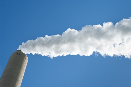 smoking industrial chimney against a blue sky  Stock Photo - 14596417