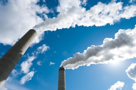smoking industrial chimneys against a blue sky Reklamní fotografie