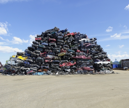 scrap heap: piled up compressed cars going to be shredded