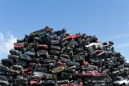 piled up compressed cars going to be shredded photo
