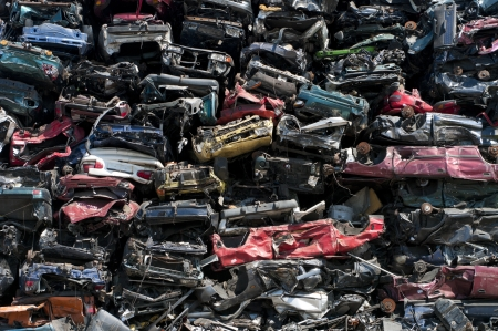 salvage yard: piled up compressed cars going to be shredded