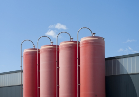 four industrial red silos belonging to a cement factory photo