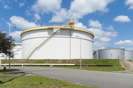 oil storage tanks in amsterdam harbor photo