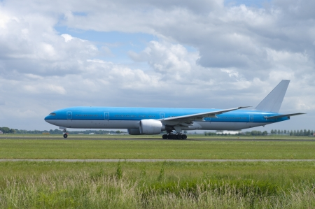 blue plane is making speed for takeoff
