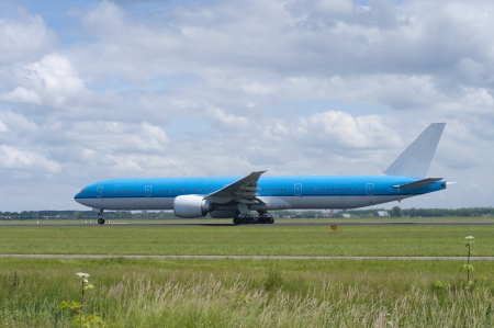 strips away: blue plane is making speed for takeoff