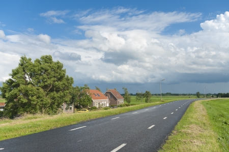 polder: road over a dyke in a typical dutch polder landscape