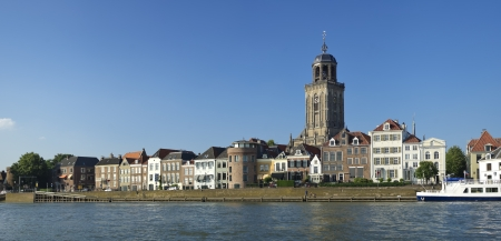 view on Deventer, Netherlands from the other side of the IJssel river. The church is the gothic Lebuïnus Church, build between 1450 and 1525.