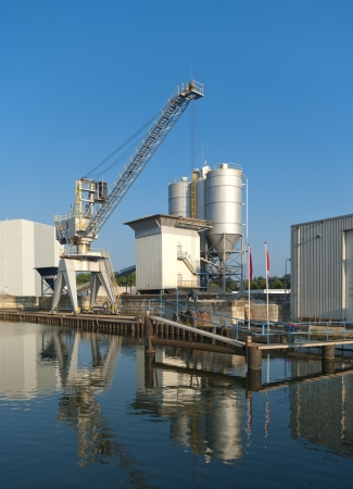 cement factory with crane and silos photo