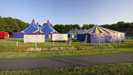 several circus tents in warm sunset light Stock Photo