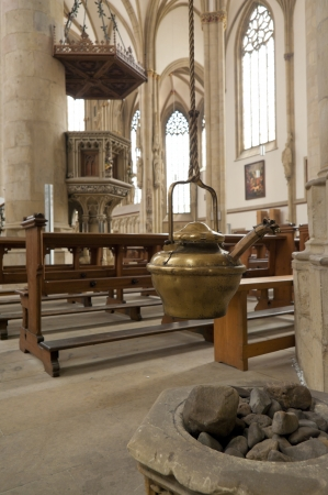 sanctified: copper pot as part of the interior of the St. Lamberti church in Munster, Germany