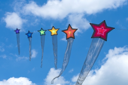 string of colorful star kites during the 3rd international kite festival in Twenterand, Netherlands Stock Photo