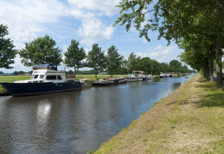 typically dutch: small canal with some motor boats