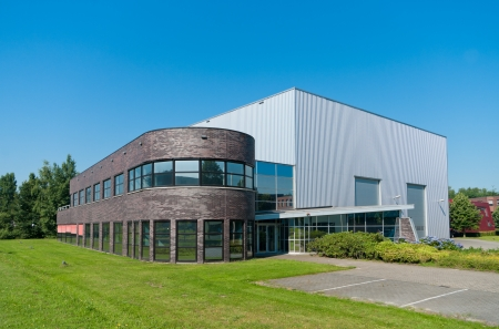 commercial real estate: modern new office building with attached warehouse