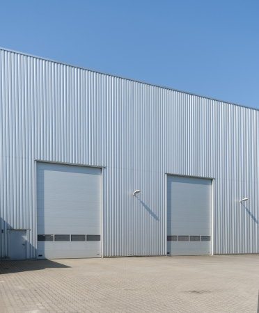 commercial docks: industrial warehouse with double roller doors Editorial