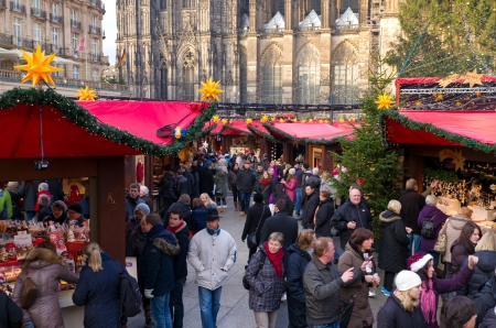 Lots of people at the christmas market in Cologne, Germany. It's one of the largest in the country with 7 separate markets all in the city center