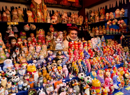 variance: woman hidden between russian dolls in a stand at the christmas market in cologne, germany