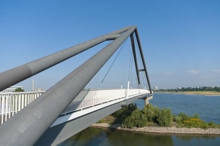modern abstract footbridge at the parlamentsufer in Dusseldorf, Germany photo