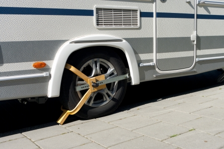 wheel clamp on a mobile home to prevent it from theft Stock Photo - 17112634