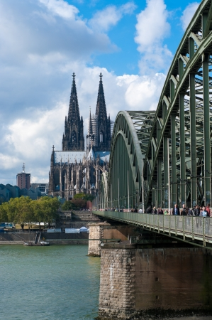 Famous Hohenzollern bridge in Cologne, Germany. It is now a rail bridge with six tracks, and due to its location near the main train station about 1200 trains pass here every day.