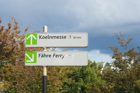messe: direction sign in Cologne pointing to the Cologne fair trade (koelnmesse)