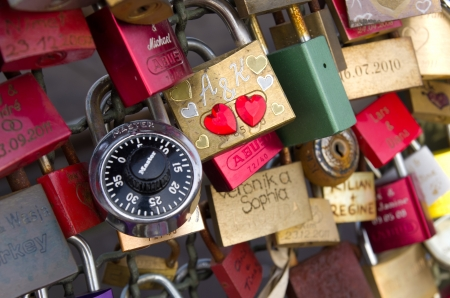 lockers at the Hohenzollern bridge in Cologne, Germany symbolize love for ever. Since 2008 people have placed love padlocks on the fence between the sidewalk and the tracks. Dutch band Nits dedicated a song to this in the song 'Love Locks' from their 2012