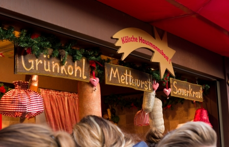 weihnachtsmarkt: food stand at the christmas market in Cologne, Germany selling traditional german food. Its one of the largest in the country with 7 separate markets all in the city center