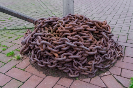 rusty chain in a harbor photo