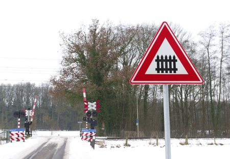 traffic sign approaching a railroad secured with automatic gate photo